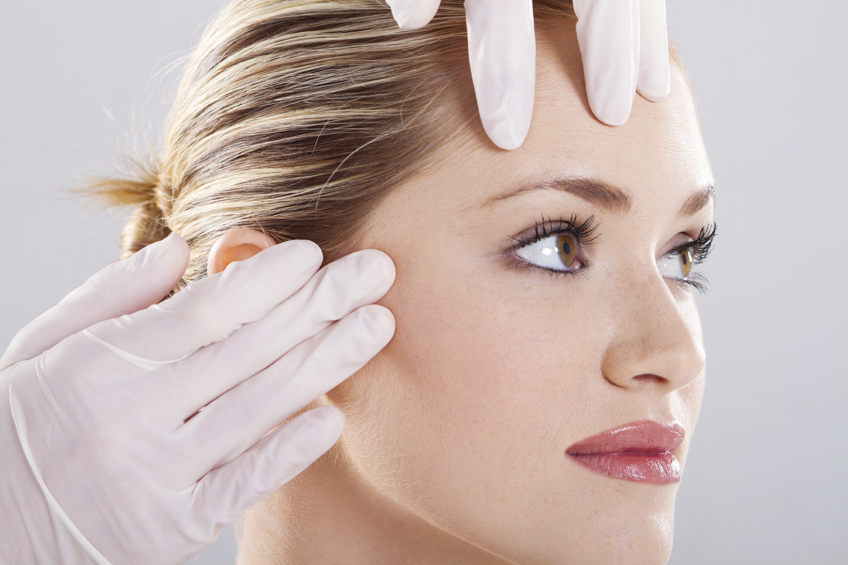 woman wondering about the better alternatives to a forehead brow lift